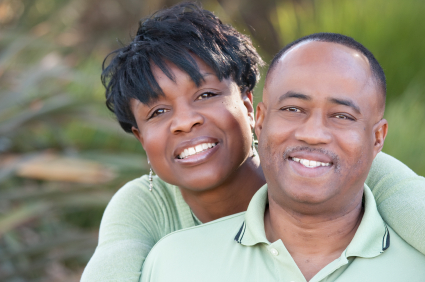 Attractive and Affectionate African American Couple posing in the park.